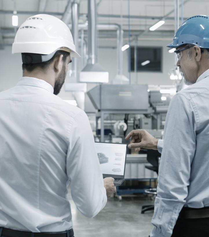 men in hard hats in factory