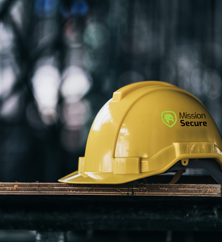 yellow hard hat with mission secure logo