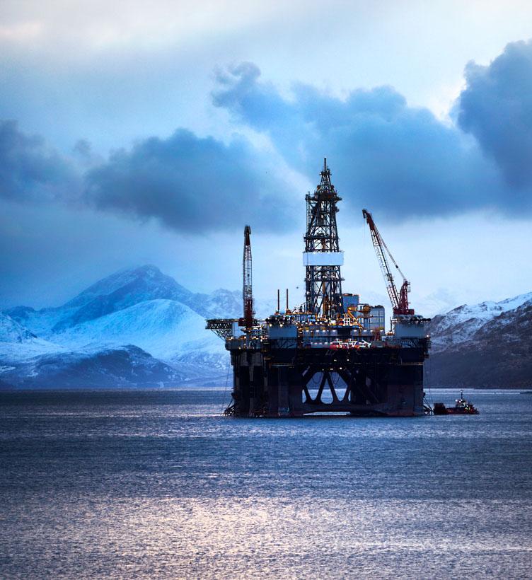 oil rig near snowy shore
