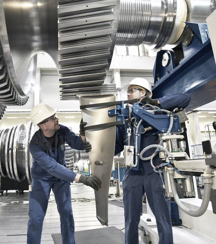 workers assembling turbine