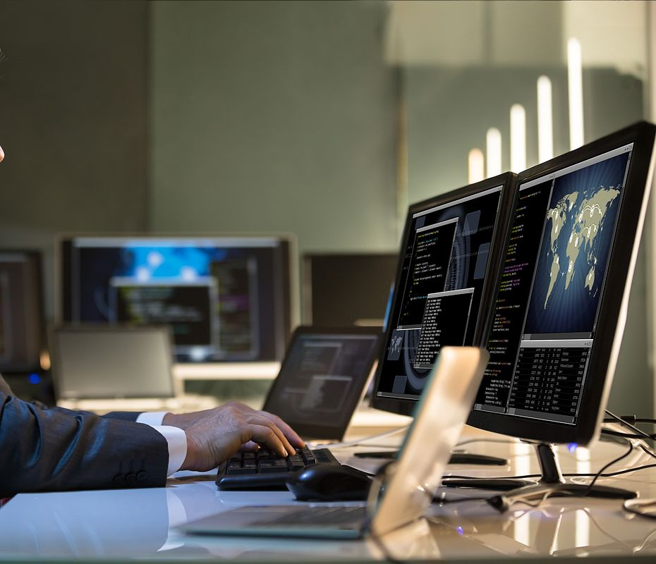 man-at-computer-and-office