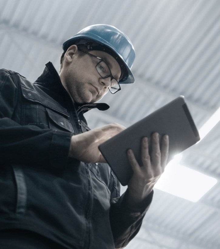 worker on tablet in warehouse